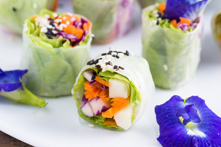Fresh vegetable noodle spring roll, with butterfly pea flower.