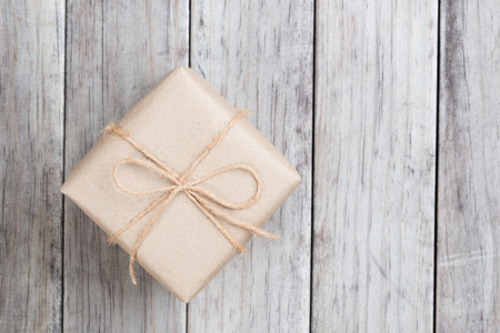 Cardboard box on a wooden background, Brown mail package parcel wrap delivery