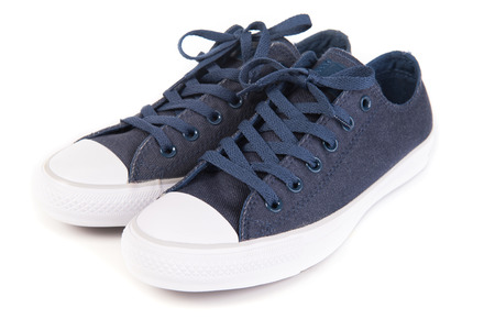 Navy blue sneakers isolated on white background