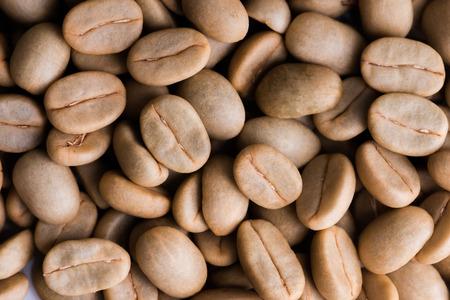 unroasted: Un-roast arabica raw coffee beans close up Stock Photo