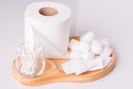 Cotton wool pad tissue roll on white background