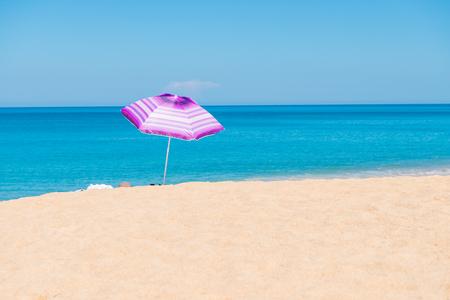 sunshades: Violet parasol , purple umbrella on the beach at sunny day phuket thailand