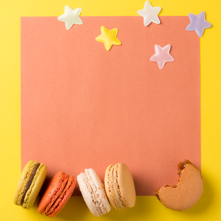 Colorful macaroons. Sweet macarons on retro  background with copy space. Stock Photo