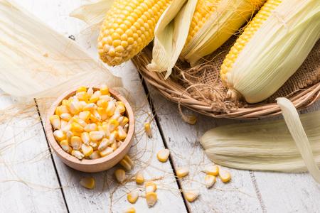 Fresh corn  on rustic wooden table, closeup, Ear of corn Stock fotó