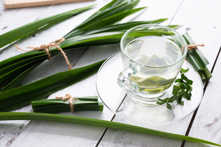Fresh Fragrant Pandan Tea and leaves on white wood background Stock Photo - 83105377