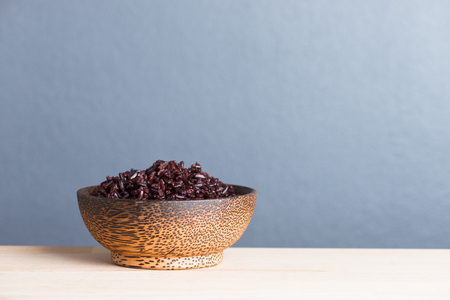 berry: Steamed rice berry on wood bowl wooden background