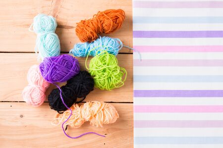 Skeins of yarn on wooden background