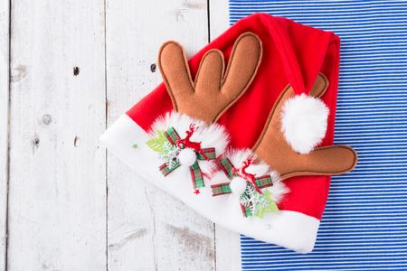 Santa red hat on wooden background