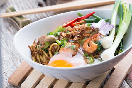 Stir fried yellow noodle mee pad hokkian phuket rice yellow noodle with soy sauce, prawn, pork, oyster and egg. Thai food phuket