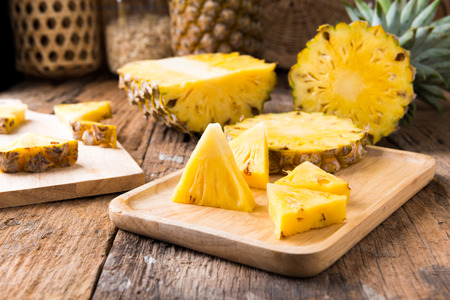 pineapple on the wooden texture background