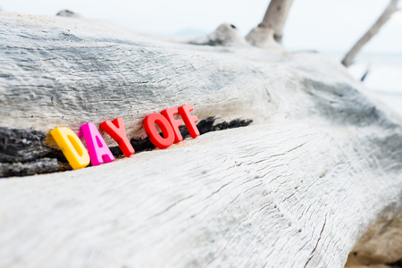 DAY OFF words on wooden background Stock Photo