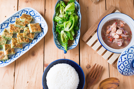 Thai food, Stir fried Cabbage  with Oyster sauce , Acacia Pennata Omelette and Shrimp-paste sauce, vegetables on wooden table background. Stock Photo