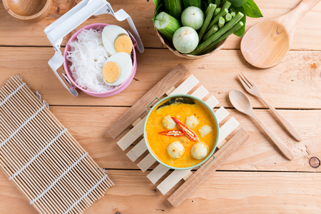 Coconut milk Curry fish and fish ball eat with thai rice noodle ( Kanom jeen nam ya ) , boiled egg and vegetable
