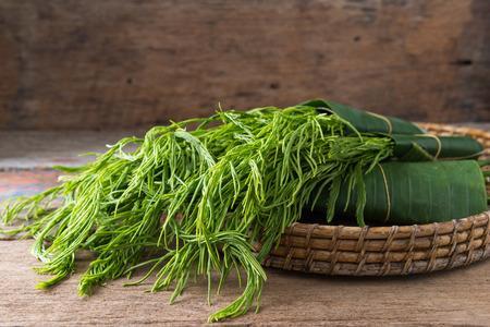 Thai local vegetable, Senegalia pennata or Acacia pennata or Cha-om (Thai Language) on wooden background