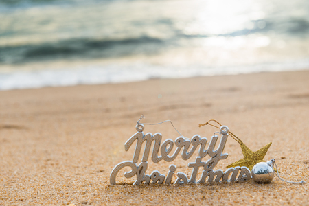 Christmas ball and decorations on the sand of tropical ocean beach , happy New Year and Merry Christmas holidays travel destinations concept