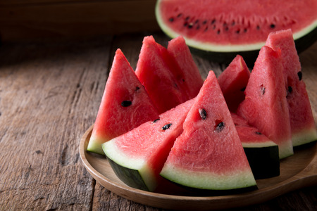Red Watermelon on wooden table background Stockfoto