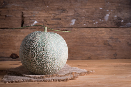 Melon on the wooden table background