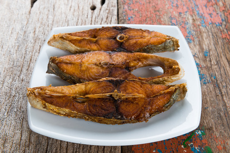 Deep fried fish on wooden table background Stock Photo