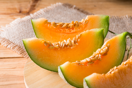 Melon slice on wooden table background