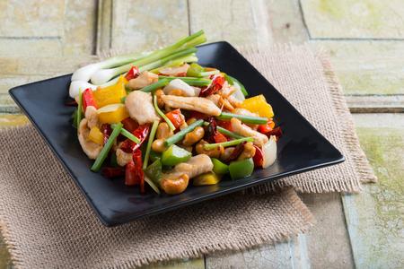 Thai food,stir fired chicken with cashew nuts on rustic wooden background Reklamní fotografie