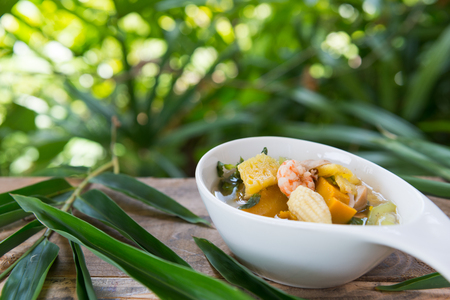 Thai Spicy Mixed Vegetable Soup with Prawns (Kang Liang Goong Sod ) with green background