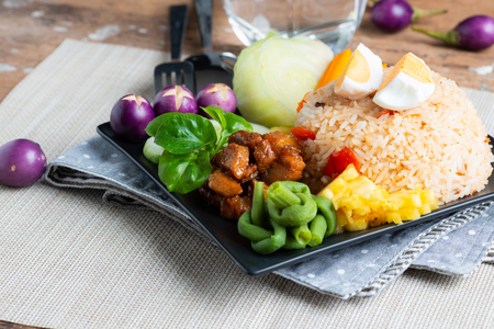 Fried rice with shrimp paste sauce  , sweet pork and mix vegetable