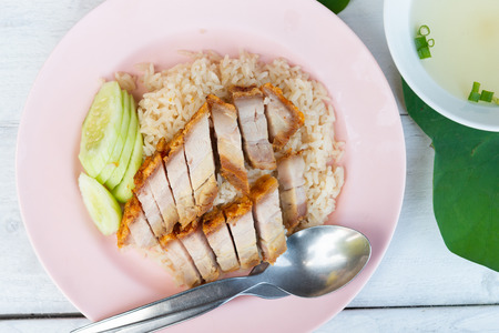 Hainanese rice with crispy pork , Thai gourmet steamed crispy pork rice , street food in thailand Stock Photo