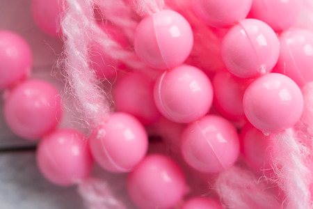 Colored plastic beads and thread beads