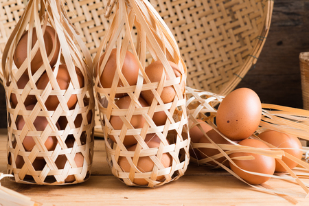 Organic eggs on wooden background. Fresh eggs. Healthy food, Rustic Style.  Easter photo concept. With round bamboo basket