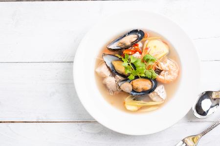 Tom Yum goong nam sai - Seafood Thai soup , famous Thai food cuisine calling Tom Yum Kung Stock Photo