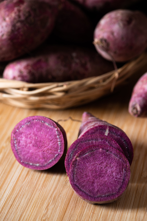 Sweet Potatoes Purple Colored on Wood Table background