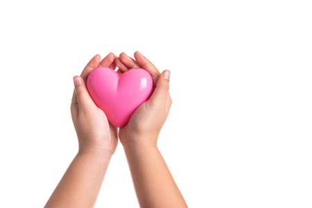 Pink heart on kid hand isolated on white background 写真素材