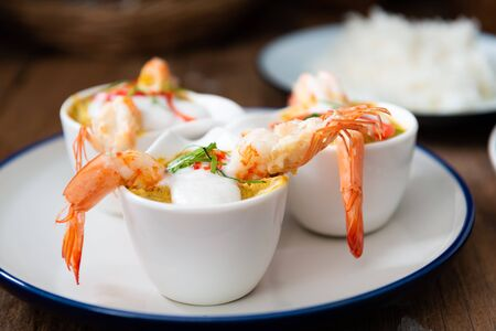 Steamed Seafood Curry Cakes (Haw Mok Thalay) with coconut cream and Prawn.