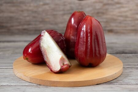 Thailand rose apple fruit flavors of sweet red gloss. Rose apple on wood background