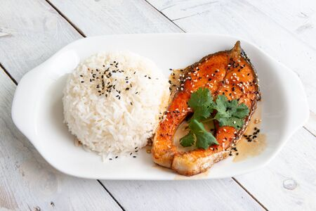 Grilled Salmon with steamed rice on white plate