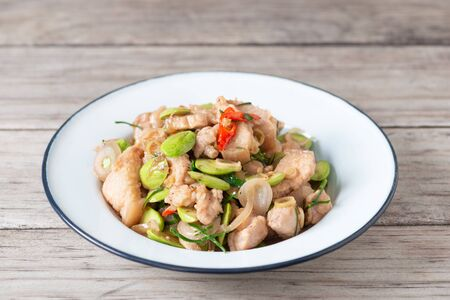 Stir Fried Pork with Shrimp Paste and bitter beans in plate