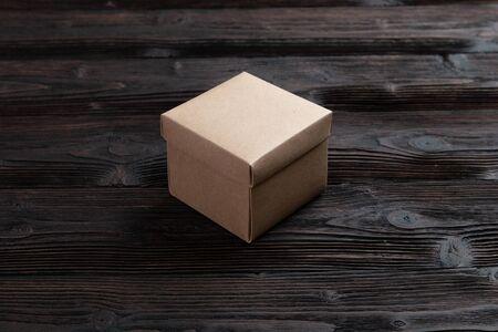 Cardboard box on a dark rustic wooden background