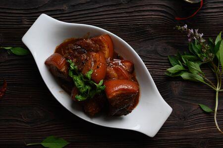 Pa-Lo Thai Braised Pork Belly , Phuket Pork Stew in white bowl