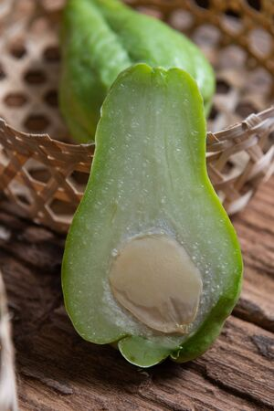 Fresh chayote fruits (Sechium edulis) on wooden background Stock Photo