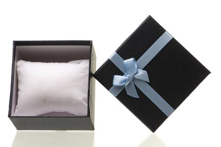 Gift box with blue ribbon isolated on white background.