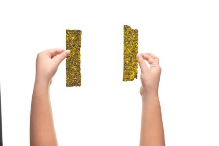 Kid hand holding Deep Fried Green Seaweed Thin Chips Crispy Snack isolated on white background
