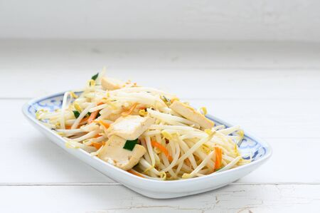 Stir Fried Bean Sprouts with tofu and scallion. Asian vegetable stir fry , asian food