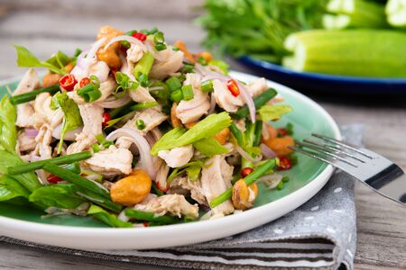 Home made steamed rip chicken spicy salad with shallot, celery, chili and Scallion.