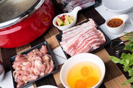 Sukiyaki . Preparation of raw materials,beef,egg ,tofu,vegetable and mung bean noodle for sukiyaki using hot pots. Asian Food