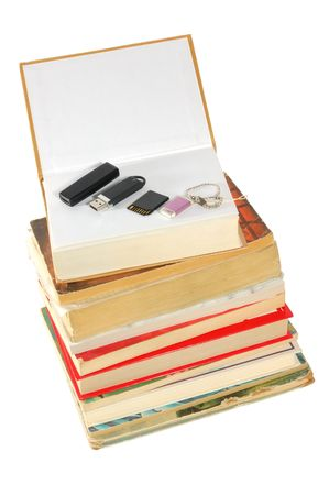 Books and flash memory on  the top, isolated on white photo
