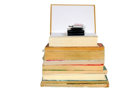 Stack of books and memory on the top, isolated on white photo