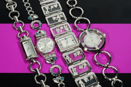 backgound:  Woman brand  watches on pink and black backgound Stock Photo