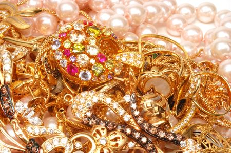 Yello gold jewelry with stones  and pearls closeup,  photo