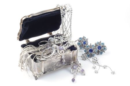 MetAl box open with  jewelry, on white Stock Photo