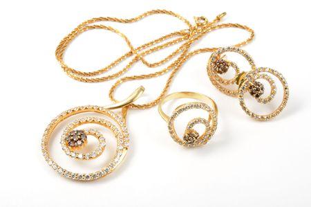 diamond necklace: Yellow gold set on white background